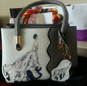 Hand bag with strap